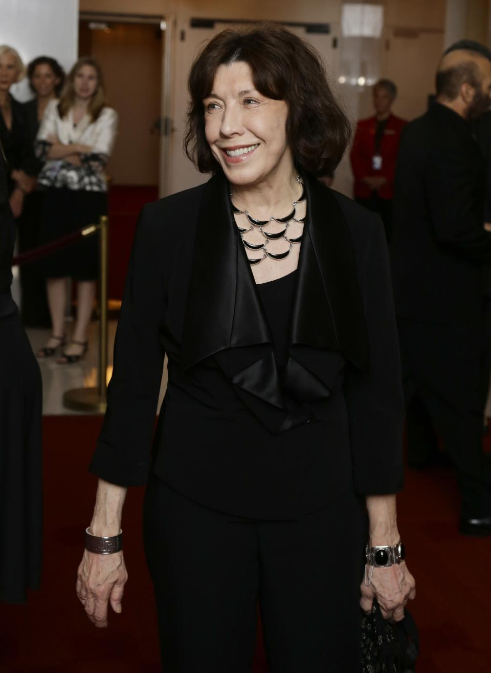 Actress Lily Tomlin poses for photographers on the red carpet before entertainer Ellen DeGeneres receives the 15th annual Mark Twain Prize for American Humor at the Kennedy Center, Monday, Oct. 22, 2012, in Washington. (AP Photo/Alex Brandon)