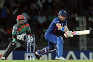 England's Luke Wright (R) during their World Twenty match against Afghanistan on September 21. Wright's match-winning 99 not out off 55 balls for England against Afghanistan in the World Twenty20 was warmly greeted by axed teammate Kevin Pietersen