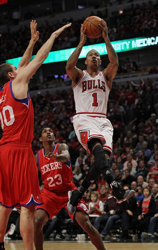 Derrick Rose #1 Of The Chicago Bulls Goes Up For A Shot Against Louis Williams #23 And Spencer Hawes #00 Of The Getty Images