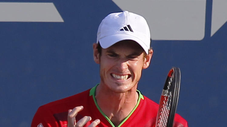 Andy Murray of Britain reacts during his match against Robin Haase of the Netherlands during the U.S. Open tennis tournament in New York, Friday, Sept. 2, 2011. (AP Photo/Paul J. Bereswill)