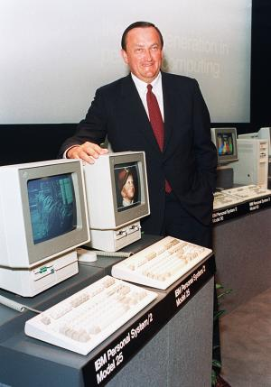 FILE - In this Aug. 4, 1987 file photo, William C. Lowe, a vice president at IBM, poses with two of the company's newest Personal System/2 computers, the model 25, at the unveiling in New York City. Lowe, who led development of the first IBM personal computer, died on Oct. 19, 2013, in Lake Forest, Ill., of a heart attack, his daughter Michelle Marshall said. He was 72. (AP Photo/Richard Drew, Fil