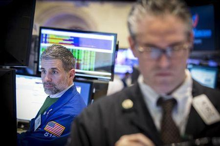 Euro posts record quarterly drop; Wall St. ends day lower