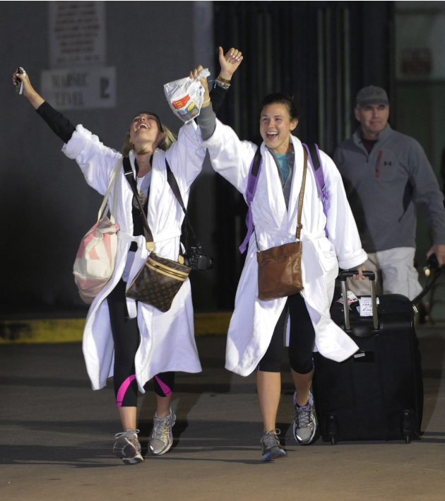 Kendall Jenkins, left, of Houston, celebrates with Brittany Ferguson, of Houston, after getting off the Carnival Triumph in Mobile, Ala., Thursday, Feb. 14, 2013. The ship with more than 4,200 passeng