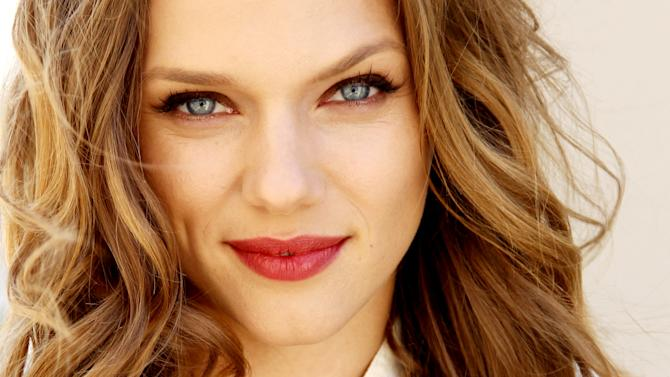 """This April 16, 2013 photo shows actress Tracy Spiridakos posing for a portrait in Los Angeles.  Spiridakos stars in the NBC series, """"Revolution,"""" airing Mondays at 10 p.m. EST. (Photo by Matt Sayles/Invision/AP)"""