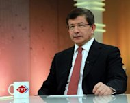 Turkish Foreign Minister Ahmet Davutoglu gives an interview to state-run TRT Television in Ankara. Davutoglu has accused Syria of shooting down one of its warplanes in international airspace. NATO said it would meet to discuss Turkey's accusation