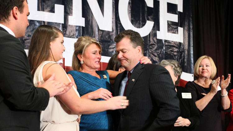 Republican Gov. candidate Dave Spence, center, turns to his wife Suzie Spence and family after announcing to his supporters that he conceded the election for Governor to Jay Nixon during a campaign party, Tuesday, Nov. 6, 2012, at the Hilton Frontenac in Frontenac, Mo. (AP Photo/St. Louis Post-Dispatch, David Carson)  EDWARDSVILLE INTELLIGENCER OUT; THE ALTON TELEGRAPH OUT