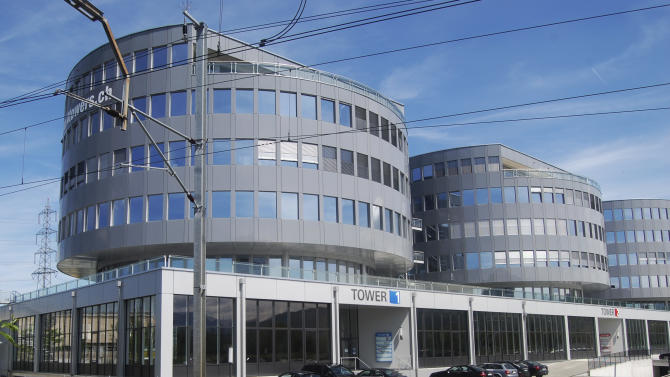 FILE - This May 11, 2010 file photo shows the outside view of Transocean's office in Steinhausen, Switzerland. Foreign executives who moved their company headquarters to Switzerland to get better tax deals for their firms may find themselves paying the price for it this weekend. A plan to crack down on excessive corporate pay packages is predicted to pass at the ballot box Sunday, March 3, 2013. (AP Photo/Frank Jordans, File)