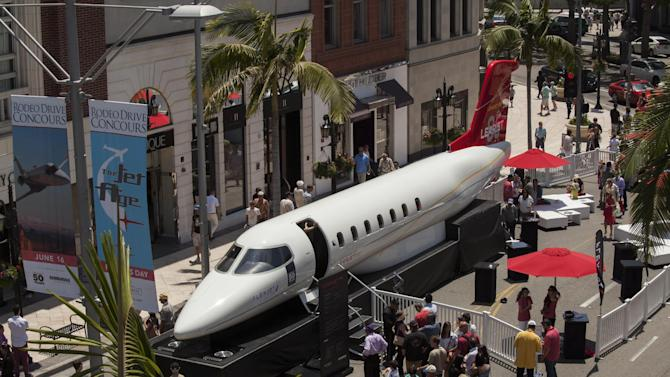 IMAGE DISTRIBUTED FOR FLEXJET - In honor of the 50th anniversary of Learjet, Flexjet - one of the world's most exclusive private jet companies - and Bombardier - the world's largest manufacturer of business aircraft - present the Learjet 85 aircraft fuselage as the first ever jet to take to the famous street during the annual Rodeo Drive Concours d'Elegance. Designed from a clean sheet, the Learjet 85 aircraft is the first business jet built primarily from carbon composites and features the latest advances in aerodynamics, structures and efficiency for a class that is truly its own. Fractional shares are available now exclusively through Flexjet. For more information, visit flexjet.com. (Jason Tinacci for Flexjet via AP Images)