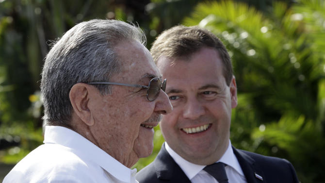 Cuba's President Raul Castro, left, and Russia's Prime Minister Dmitry Medvedev attend a wreath-laying ceremony at the Internationalist Soviet Soldier mausoleum in Havana, Cuba, Friday, Feb. 22, 2013. (AP Photo/Franklin Reyes)