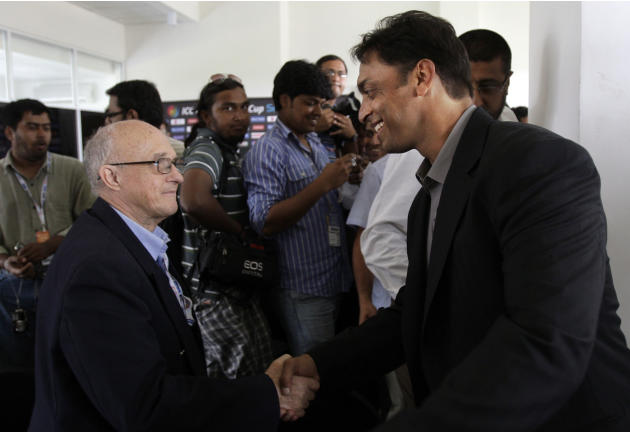 Pakistan's fast bowler Shoaib Akhtar, right, shakes hands with cricket journalist Trevor Chesterfield at the end of a news conference after a training session in Colombo, Sri Lanka, Thursday March 17,
