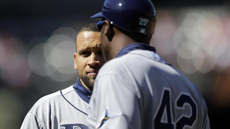 Tampa Bay Rays' James Loney speaks with first base coach George Hendrick during a baseball game against the Baltimore Orioles, Wednesday, April 16, 2014, in Baltimore. (AP Photo/Patrick Semansky)