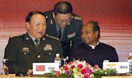 Chinese Defence Minister Liang Guanglie (L) talks with his Indian counterpart A. K. Antony at the end of an Association of Southeast Asian Nations defence ministers' meeting in Hanoi in 2010. Defence ministers of India and China are set to meet for talks on Tuesday with concerns over competing influence across South Asia likely to be high on the agenda, according to officials