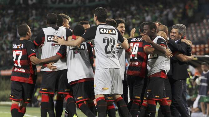 Players of Brazil's Vitoria celebrates a goal by Henrique against Atletico Nacional of Colombia during Copa Sudamericana soccer match in Medellin