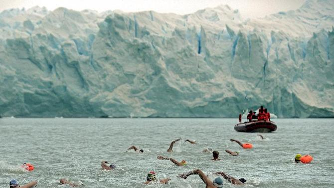 People take part in the Winter Swimming Festival in front of the Perito Moreno glacier, at the Argentino Lake in El Calafate, Santa Cruz province, Argentina, on August 8, 2014