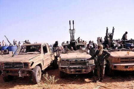 Members of the Sudanese Armed Forces (SAF) and the Rapid Support Forces (RSF) in rebel vehicles which they captured, attend victory celebrations after they defeated the Justice and Equality Movement (JEM) rebels in Gouz Dango