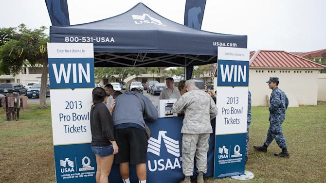 Fans line up to register to win game day tickets during NFL Pro Bowl Practice at Joint Base Pearl Harbor Hickam, Thursday, Jan. 24. 2013 in Honolulu.  (Marco Garcia/AP Images for USAA)