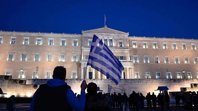 Greece's government outlined a first batch of measures to combat poverty, including free electricity, rent support and food stamps, to be approved by parliament in the coming days