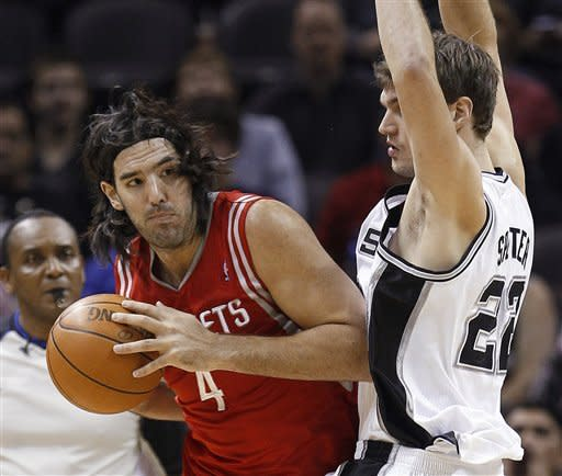Parker helps Spurs beat Rockets in overtime