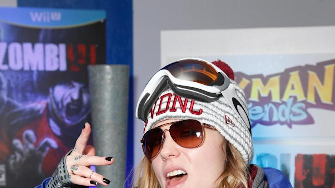 IMAGE DISTRIBUTED FOR NINTENDO  - Singer Skylar Grey warms up and checks out Wii U at the Nintendo Lounge during a break from the Sundance Film Festival on Friday, January 18, 2013 in Park City, UT. (Photo by Todd Williamson/Invision for Nintendo/AP Images)