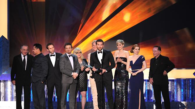 """From left, Robert De Niro, Michael Pena, Alessandro Nivola, Jeremy Renner, Colleen Camp, Elisabeth Rohm, Bradley Cooper, Jennifer Lawrence, Amy Adams and Paul Herman accept the award for outstanding performance by a cast in a motion picture for """"American Hustle"""" at the 20th annual Screen Actors Guild Awards at the Shrine Auditorium on Saturday, Jan. 18, 2014, in Los Angeles. (Photo by Frank Micelotta/Invision/AP)"""