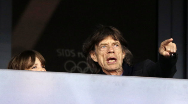 Musician Mick Jagger watches an evening session of athletics in the Olympic Stadium at the 2012 Summer Olympics, London, Monday, Aug. 6, 2012. (AP Photo/Matt Slocum)