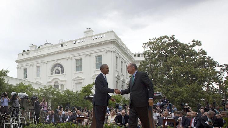 President Barack Obama shakes hands with Turkey's Prime Minister Recep Tayyip Erdogan following their news conference in the Rose Garden of the White House in Washington, Thursday, May 16, 2013. (AP Photo/Pablo Martinez Monsivais)