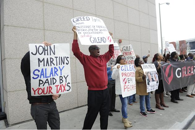 Michael Robinson, second from left,  and other protesters from the Atlanta Drug Pricing Forum demonstrate against high drug prices, outside the Conference on Retroviruses and Opportunistic Infections