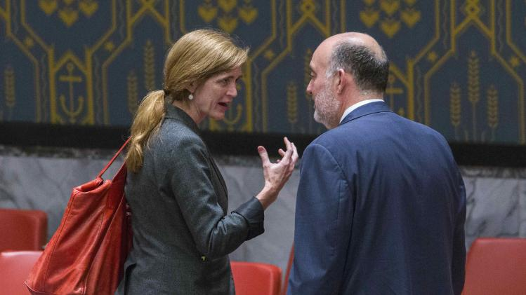 Israel's U.N. Ambassador Ron Prosor speaks with U.S. Ambassador to the United Nations Samantha Power before a midnight meeting of the Security Council at the headquarters in New York