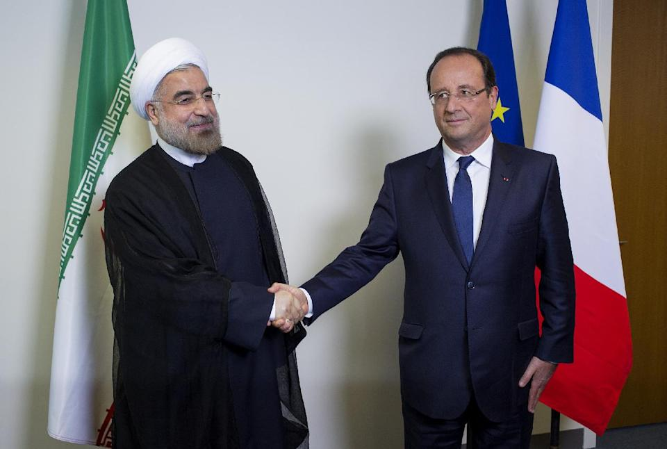 Iranian President Hasan Rouhani shakes hands with French President Francois Hollande during the 68th session of the United Nations General Assembly at United Nations headquarters Tuesday, Sept. 24, 2013. (AP Photo/Craig Ruttle)
