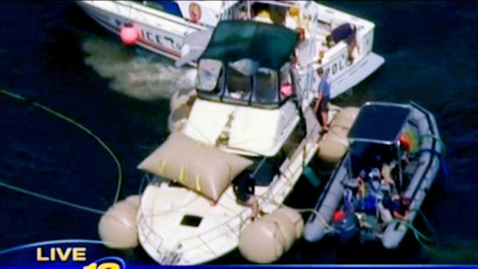 This image made from video and provided by News 12 Long Island shows the Kandi Won from the air on Oyster Bay, off the shore of New York's Long Island, Wednesday, July 11, 2012. The yacht that capsized and sank on July 4, killing three children, has been lifted from the bottom of the bay and will be brought to shore. (AP Photo/News 12 Long Island) MANDATORY CREDIT