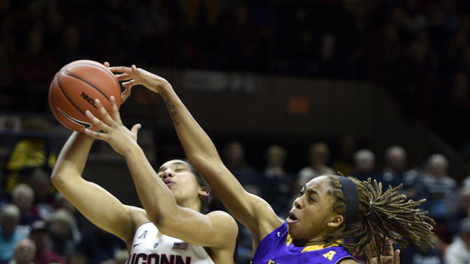 Connecticut's Gabby Williams (15) is fouled by East Carolina's DeVaughn Gray (4) during the second half of Connecticut's 92-46 victory in an NCAA college basketball game in Storrs, Conn., on Saturday, Feb. 6, 2016. (AP Photo/Fred Beckham)