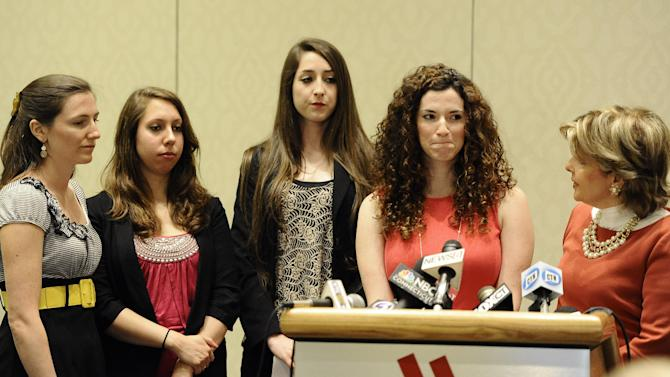 ADDS IN HARTFORD, CONN University of Connecticut student Rosemary Richi, at podium, answers questions from the media as attorney Gloria Allred, right, Kylie Angell, left, Erica Daniels, second from left, and Carolyn Luby, look on, during a news conference, Friday, July 18, 2014, in Hartford, Conn. The University of Connecticut will pay nearly $1.3 million to settle a federal lawsuit filed by five women who claimed the school responded to their sexual assault complaints with indifference, the two sides announced Friday. (AP Photo/Jessica Hill)
