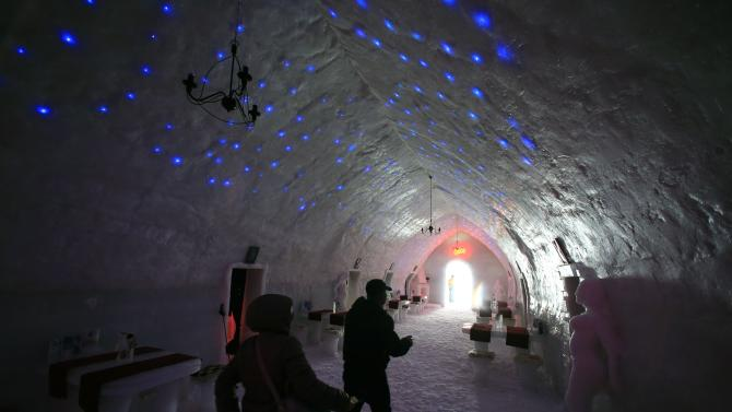 Tourists visit the Balea Lac Hotel of Ice in the Fagaras mountains