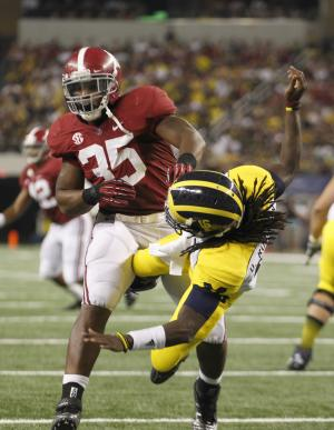 Alabama linebacker Nico Johnson (35) knocks Michigan quarterback Denard Robinson (16) off his feet after a pass during in the second half of an NCAA college football game at Cowboys Stadium in Arlington, Texas, Saturday, Sept. 1, 2012. A flag against Alabama was called on the play. Alabama won 41-14. (AP Photo/LM Otero)