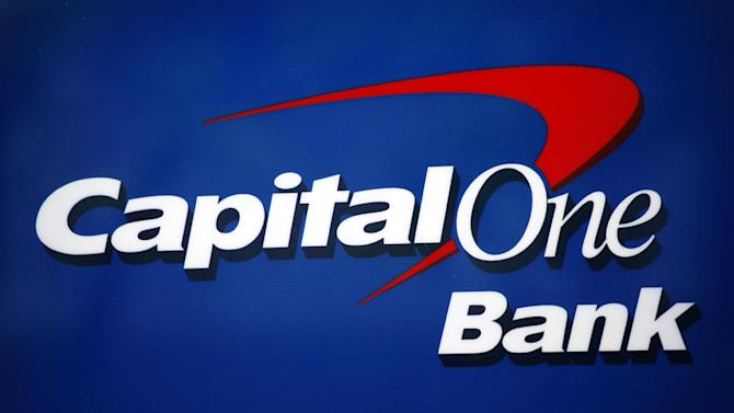 FILE - This June 23, 2010, file photo shows a Capitol One Bank in New York. Capital One Financial Corp. reports quarterly financial results after the market closes on Thursday, April 18, 2013. (AP Photo/Mark Lennihan)