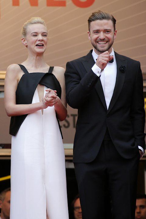 Actors Carey Mulligan, left, and Justin Timberlake laugh as they arrive for the screening of the film Inside Llewyn Davis at the 66th international film festival, in Cannes, southern France, Sunday, M