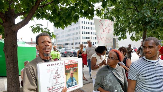 Protesters rally outside the office of St Louis County prosecutor Robert McCulloch, demanding the arrest of Darren Wilson on August 20, 2014