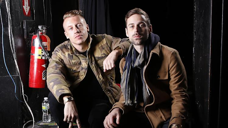 "FILE - This Nov. 20, 2012 file photo shows Ben Haggerty, better known by his stage name Macklemore, left, and his producer Ryan Lewis at Irving Plaza in New York. The rapper Macklemore thinks there's a simple reason his hit ""Thrift Shop"" appears to be going viral: It dares to be different. The Seattle-based duo has sold 2.3 million copies so far _ a million in the last month alone _ and sales continue to grow week to week. (Photo by Carlo Allegri/Invision/AP, file)"