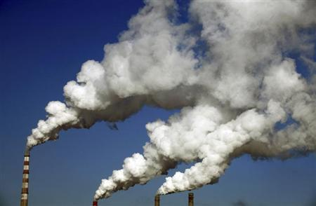 Smoke billows from chimneys of a heating plant in Jilin