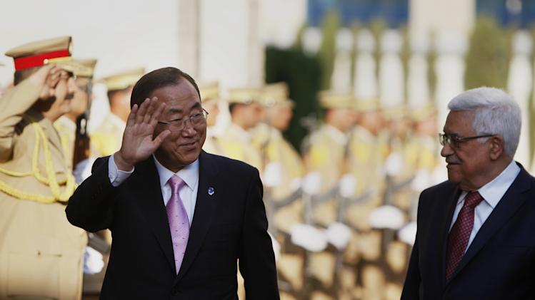 Palestinian President Mahmoud Abbas??, right, walks with UN Secretary-General Ban Ki-moon upon his arrival in the West Bank city of Ramallah, Thursday, Aug. 15 , 2013. (AP Photo/Majdi Mohammed)