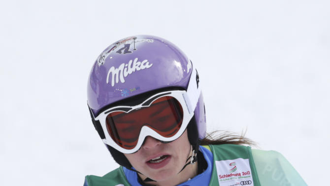 Slovenia's Tina Maze reacts after the women's downhill training at the Alpine skiing world championships in Schladming, Austria, Thursday, Feb.7,2013. (AP Photo/Matthias Schrader)