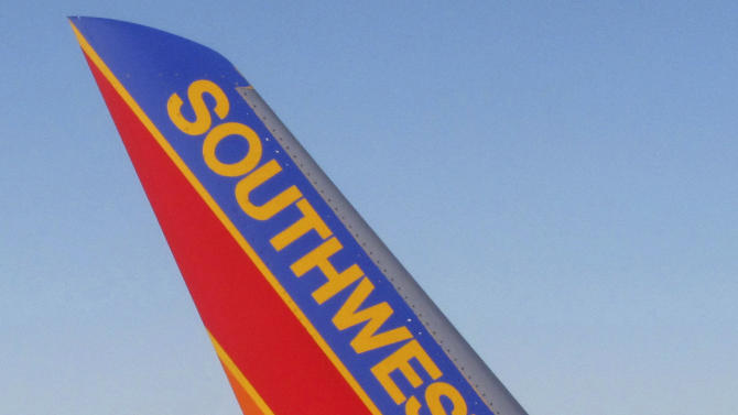 FILE - In this file photo taken Feb. 28, 2011, Southwest Airlines planes are shown at McCarran International Airport in Las Vegas. Boeing (NYSE: BA) and Southwest Airlines today announced a firm order for 150 fuel-efficient 737 MAX airplanes. Southwest is the first customer to finalize an order for the 737 MAX and becomes the launch customer for the new-engine variant. The Dallas-based carrier also ordered 58 Next-Generation 737s. (AP Photo/Ted S. Warren, File)