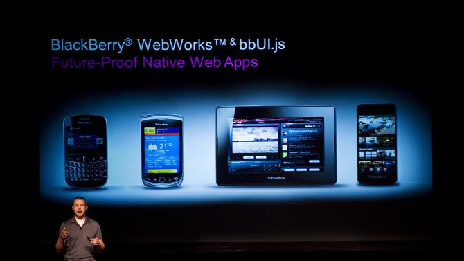 FILE - In a Thursday June 21, 2012 file photo, Tim Neil, Research In Motion Ltd.'s Canadian Operating Director of Operations, Platforms and Tools, speaks about the Blackberry 10 architecture during the RIM Blackberry 10 Jam World Tour in Toronto. Struggling BlackBerry-maker Research in Motion said Friday, Sept. 21, 2012 it resolved an outage affecting users in Europe, Middle East and Africa that had interrupted service for customers on the very day Apple Inc. unveiled its new iPhone 5. Jefferies analyst Peter Misek said he thinks the transition to the BlackBerry 10 software intended to run their new line of smartphones, could be a cause of the outage.  (AP Photo/The Canadian Press, Aaron Vincent Elkaim, File)
