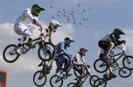 Cyclists compete in a BMX cycling men&#39;s quarterfinal run during the 2012 Summer Olympics, Thursday, Aug. 9, 2012, in London. (AP Photo/Matt Rourke)
