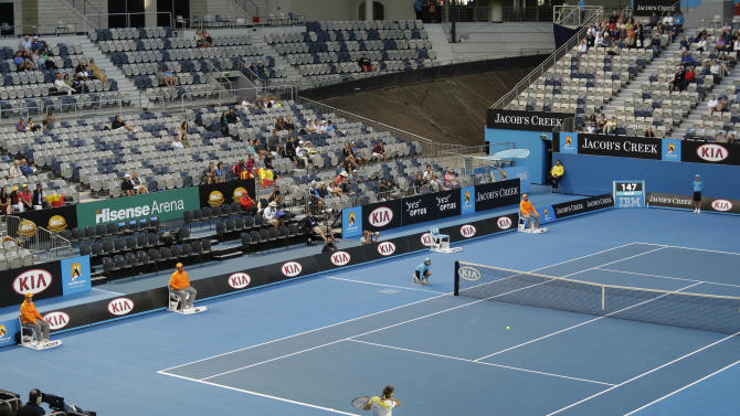 Spain's David Ferrer makes a forehand return to Belgium's Oliver Rochus during their first round match in the Hisense Arena at the Australian Open tennis championship in Melbourne, Australia, Monday, Jan. 14, 2013. (AP Photo/Rob Griffith)