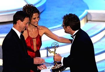 Gary Sinise and Melina Kanakaredes presenting James Spader of &quot;The Practice&quot;