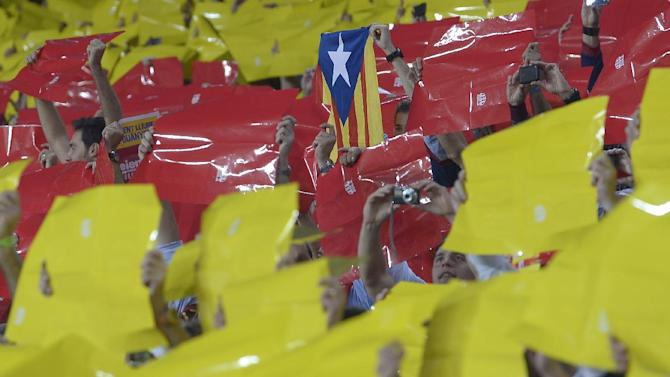 "Barcelona soccer fans hold up 'Estelada', center, the Catalan independence flag, amongst color cards forming the red-and-yellow stripes of Catalonia's ""la senyera"" flag before the Spanish La Liga soccer match between FC Barcelona and Real Madrid at the Camp Nou stadium in Barcelona, Spain, Sunday, Oct. 7, 2012. Moves toward separatism are getting a bigger following these past months as the economic crisis pushes people faster toward stark choices on nationhood and their future. It is no different in Spain's Catalonia, a wealthy region grousing that it has to pay for others in its crisis-hit country. Real Madrid is still identified with the unified Spanish state and was met with a mosaic of color cards forming the red-and-yellow stripes of Catalonia's ""la senyera"" flag. At one stage during the match, incessant collective shouts of ""Independence!"" cascaded down the stands as fans waved the pro-independence ""estelada"" flag. (AP Photo/Manu Fernandez, File)"