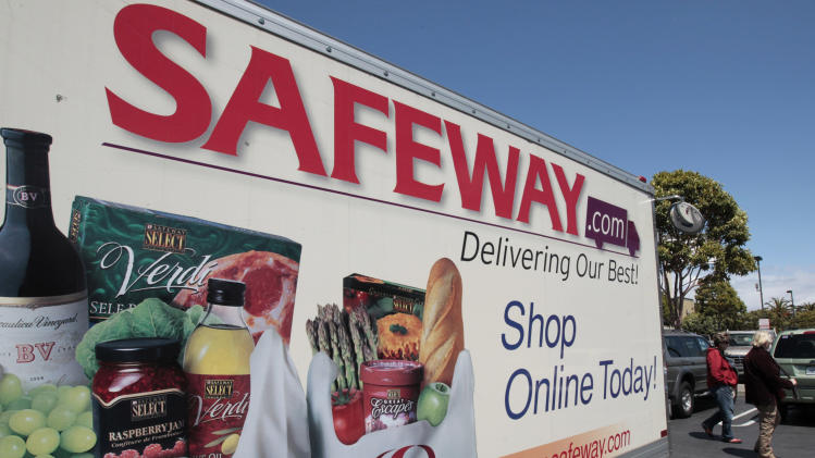 FILE- In this Thursday, April 26, 2012, file photo, a Safeway online shopping advertisement is shown at a Safeway store in San Francisco. Safeway Inc. said Thursday, Oct. 11, 2012, its profit margin slipped in the third quarter as it spent money on launching a new customer loyalty program, an investment the supermarket operator said should drive sales going forward. The sale of its Genuardi's chain helped offset the decline and pushed the company's net income up 21 percent. (AP Photo/Paul Sakuma, File)