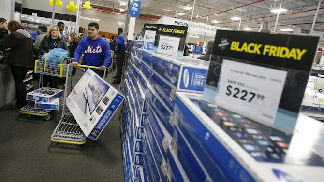 Shoppers leave with check out with their purchases from  the Best Buy store in Westbury, New York