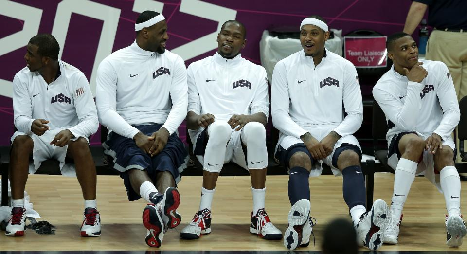 United States players from left, Chris Paul, Labron James, Kevin Durant, Carmelo Anthony, and Russell Westbrook sit on the bench during a men's basketball game against Nigeria at the 2012 Summer Olympics, Thursday, Aug. 2, 2012, in London. (AP Photo/Charlie Riedel)